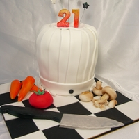 21St Chefs Cake White choc mud cake, all decorations are fondant. Thanks for looking!
