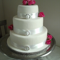 White Satin & Pink 4 Teir Wedding Cake