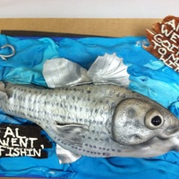Gone Fishin' Retirement Cake  A striped bass retirement cake -- choc cake- 9x13 carved- LMF fondant- hand painted and dusted. I'm thrilled with the way this cake...