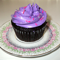 Purple And Pink Chocolate Jumbo Cupcake Made big cupcakes for a 4 year olds birthday. Purple white chocolate frosting with pink and purple sprinkles, on vegan chocolate cake.