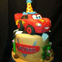 Laurel's Lightning Mcqueen Cake This was my first time attempting Lightning McQueen. He is made from RKT covered in fondant. All other decorations are fondant.