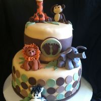 Jungle Animal Baby Shower Cake   All animals made from fondant. White cake, almond buttercream icing.