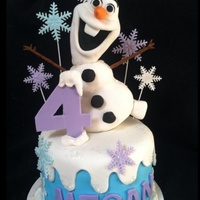 "Frozen Olaf Cake   This is a small 6"" cake. Olaf is Rice Krispy Treats covered with fondant. White cake, buttercream icing."
