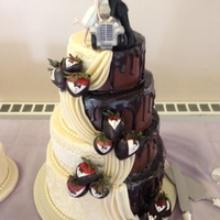 Half Bride/half Groom Tiered Wedding Cake The chocolate drizzle was made from scratch using 1 part milk chocolate chips and 1 part heavy whipping cream. Mixed the 2 in a glass...