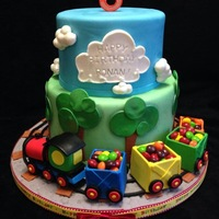 Train Birthday Cake Train & box car birthday cake for little boy. Box cars were made by cutting 5 squares of fondant and letting them dry flat, then using...