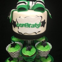 Cheerleader Banquet Cupcake Tier Top tier featured 6-inch cake with gum paste cheerleader bow