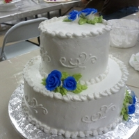 Two Tier   two tier marble cake. 10in bottom, 6 in top. buttercream gum paste roses dusted with royal blue.