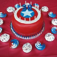 "Captain America Cake Snickers themed cake (three 10"" chocolate layers filled with nougat and caramel buttercream frosted in milk chocolate ganache) covered..."