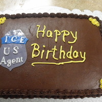 I.c.e. Agent Chocolate on Chocolate buttercream. Badge is fondant and gumpaste.
