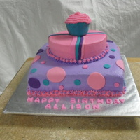1St. Birthday Cake WASC with lavendar buttercream on the bottom, and pink buttercreamon the top and a giant cupcukes cover with teal fondant and pink...