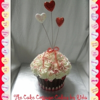 Valentines Giant Cupcake Yellow cake with buttercream icing and border with valentine corn.