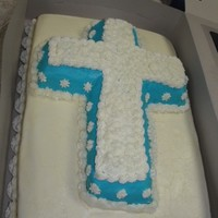 Christening Cake WASC with buttercream icing bottom layer, cross chocolate with blue buttercream.