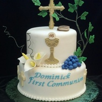 First Holy Communion Cake Cross is chocolate, bible is gum paste, chalice and Eucharist are hand made, with gum paste ivy, modeling chocolate grapes, chocolate...