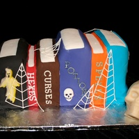 Spell Books   Halloween cake of books and skull is RKT covered in modeling chocolate.