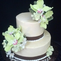 "Green Orchids Wedding Cake   Buttercream 10"" and 6"" cakes with green orchids."