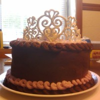 Birthday Cake Fit For A Queen This is a royal icing tiara with a tootsie roll rose. My mom was very happy to be queen for the day.
