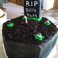 Over The Hill Headstone is and oval cake cut in half and covered in fondant. Ground is crushed up oreos but I would suggest scraping off the creme before...