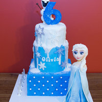 "Frozen - Elsa And Olaf 'Frozen' themed cake for my little one 8"" Square lemon cake filled and coated with white chocolate ganache, covered in..."