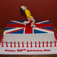 "Freddie Mercury And The Union Jack 14""x10"" White chocolate mud cake, filled and coated with white chocolate ganache, covered in fondant.Modelling chocolate and..."