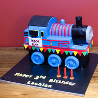 Thomas The Tank Engine Orange and chocolate fudge cake with milk chocolate ganache and fondant.