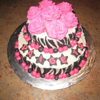 Hot Pink Zebra Birthday! Red Velvet cake with cream cheese filling and frosting. Royal Icing roses with fondant zebra accents.