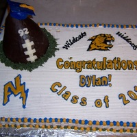 Football Graduation Football graduation cake made with a rice crispy/modeling chocolate football and color flow decals.