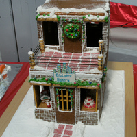 City Lights Gingerbread Bakery Bakery I wanted to own someday. I entered it into a State Fair competition. I did not win and the judge criticized it saying I should have...
