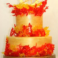 Hunger Games Challenge Boiled sugar flames with a gum paste topper. Cake is handpainted in gold, orange and red. Thanks for looking!