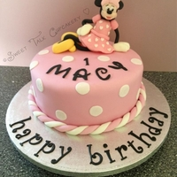 Minnie Mouse Cake Vanilla sponge topped with sugarpaste Minnie Mouse topper. :)