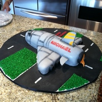 "Airplane / Rocket Cake This was for an 8 year old boy. Mom didn't give me any guidance other than ""he loves any airplanes"". My husband claims that..."