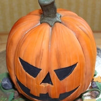 Halloween Pumpkin Vanilla madeira cake (marbled green) with green vanilla buttercream covered in fondant.