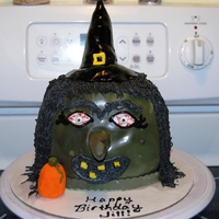 Halloween Witch Witch cake for a friend's birthday. Used the Wilton Pumpkin Pan, covered in fondant, used grass tip for hair. All edible except for...