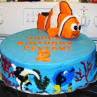 Finding Nemo Cake 12' Vanilla Almond w/raspberry buttercream. Coral/seaweed BC, accents on cake fondant and Nemo is RKT covered in fondant.