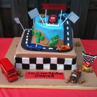 "Cars Cake 12"" and 8"" square cakes, with the corner of the top cake rounded to accomodate the scene. I hope you all like it!"