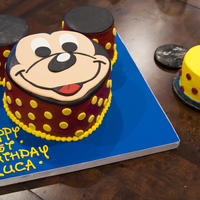 "Mickey Mouse Carved from an 8"" round, covered in MFF, buttercream writing... and the matching smash cake on a Mickey-shaped board. TFL"