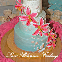 Beach Theme Wedding With Stargazers  I hand made the sugar flowers, anchor and half the shells. Some shells were molded due the tiny size of them. This was a 4,6,8 inch cake....