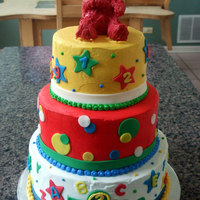3 Tiered Elmo Cake 3 Tiered Elmo cake, covered in buttercream frosting with fondant cut-out decor. Elmo topper is made of rice crispie treats covered in red...