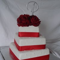 1St Wedding Cake 1st wedding cake I have ever made, and it is decorated just as the bride asked. It is red velvet cake with cream cheese filling/buttercream...