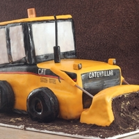 Construction Vehicle This cake is all triple chocolate filled and frosted with vanilla buttercream and covered in MMF.