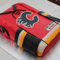 Calgary Flames Jersey Red Velvet cake filled and frosted with fluffy american buttercream and covered in fondant.