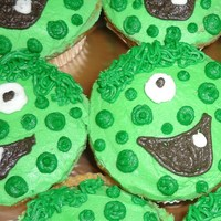 Green Monsters Vanilla cupcakes with buttercream icing. For a boy's 11th birthday - he wanted green monsters for the boys and pink ones for the girls...