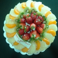 Mixed Fruit vanilla sponge soaked in fruit syrup, with fresh fruit and cream