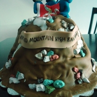 "Mountain Climbers Chocolate cake to congratulate a trio that climbed Mount Kilimanjaro. Rocks are chocolate rocks. The banner says ""Aint no mountain..."