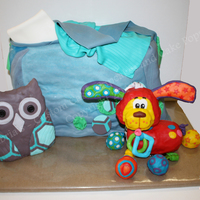 Diaper Bag And Toys This was an alternating layered cake (chocolate and butter) filled with chocolate buttercream, iced in white chocolate buttercream, covered...
