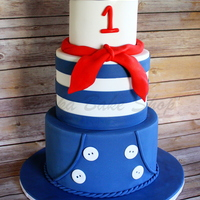 "French Sailor Cutie French sailor theme cake: 9"" tier dressed with sailor pant; 7"" striped sailor ""tee"" tier topped with red scarf; and 5&..."