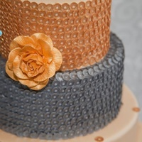 Blinged Out Wedding Cake Edible sequin cake in silver and gold. Gold gumpaste rose accent