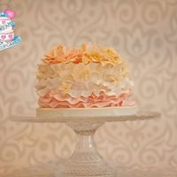 Ruffles And Flowers Cake Gumpaste flowers and ruffles in an ombre pattern