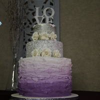 Plum Ombre Frilled Wedding Cake double barreled base with plum ombre frilling, edible sequin center tier and silver Cake Lace top tier with gumpaste tea roses