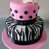 Zebra Print Zebra print, handmade fondant flower on top, red velvet cake with cream cheese frosting inside!