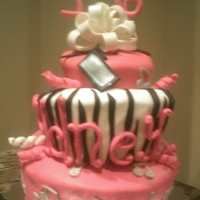"Pink Black & Silver Sweet 16 This is a 16th birthday cake. 10', 8"" and 6' on top. All decorations were made of mmf. I painted the music notes with clear..."